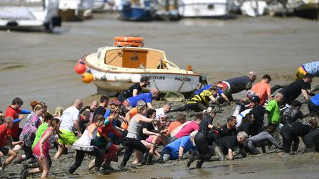 A crowd of competitors taking part in the annual Maldon Mud Race Picture: Joe Giddens/PA Wire