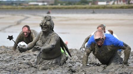 Competitors taking part in the annual Maldon Mud Race Picture: Joe Giddens/PA Wire