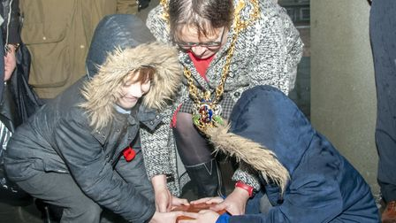Daman and Riley O'Donnell help to lower the time capsule into place under Cornhill.