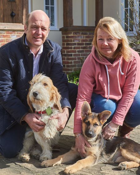 Craig and Gail Williamson of Barn Farm Drinks with two of their dogs, Dexter and Pepper. Picture: