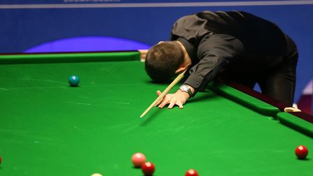 Ronnie O'Sullivan reacts after missing a pot during day four of the 2019 Betfred World Championship