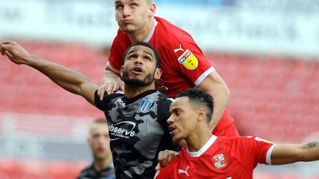 Luke Woolfenden towers above the U's Mikael Mandron, who will be leaving the Essex club after two ye