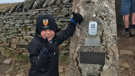 Seven-year-old Alastair Emrich from Colchester completed the Yorkshire Three Peaks Challenge in less
