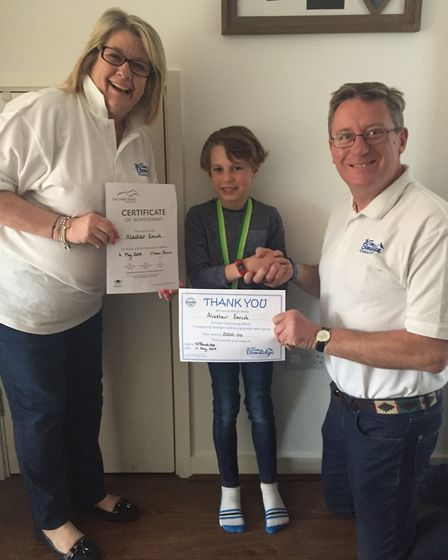 Alastair presented with a thank you by Nikki and Richard Bowdidge of the Tom Bowdidge Youth Cancer F