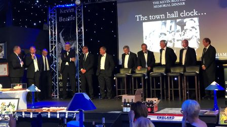 Host Mark Murphy on stage with former Town stars at Gresham - from left, George Burley, Simon Milton