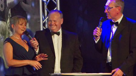 Kevin's daughter Emma, host Mark Murphy and Terry Butcher on stage at Greshams Ipswich Picture: Iai