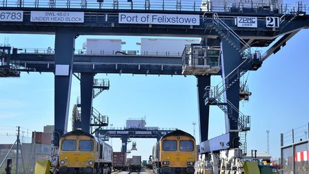 A GB Railfreight train sitting below a crane at the Port of Felixstowe, which is now linked to iPort