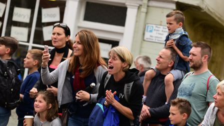 Hundreds of spectators lined the streets to cheer on the runners in the 10K and junior races. Pictur