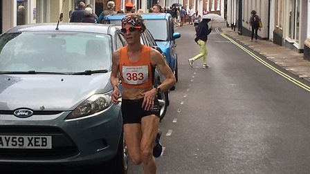 Helen Davies, striding out at the Woodbridge 10K. Davies broke the female course record and finished