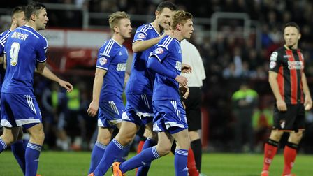Teddy Bishop is congratulated by Tommy Smith after scoring at Bournemouth in 2014. Photo: Pagepix