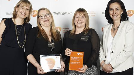 Hayley Hancock and Kirsten Alderson (middle) from Suffolk Family Carers with the award Picture: LISA