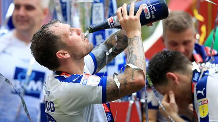 James Norwood celebrates Tranmere's promotion at Wembley. Picture: PA