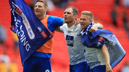 James Norwood celebrates Tranmere's promotion at Wembley with Paul Mullin and Jay Harris. Picture: P