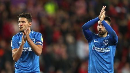 Portsmouth's Gareth Evans and Ben Close. The south coast club will be among the League One favourite