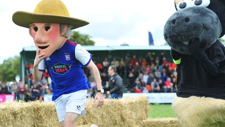 Tractor Boy makes his debut in the mascot race Picture: SARAH LUCY BROWN