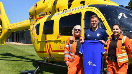 Ipswich Town academy coach Shaun Whiter with an East Anglian Air Ambulance doctor and paramedic. Pho
