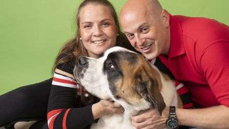 Wilson the St Bernard with owners Zoe Thorne and Jeff Clark Picture: MARK BAILEY