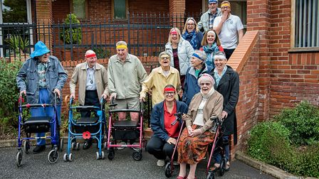 Residents and staff of Seckford Almshouses preparing to go on their walk Picture: SIMON LEE PHOTOGRA