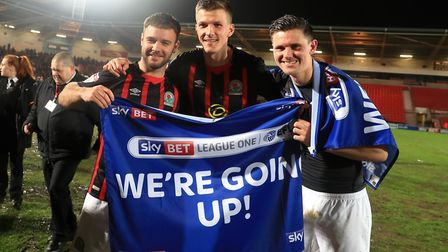 Paul Downing (centre) celebrates League One promotion with Blackburn. Photo: PA
