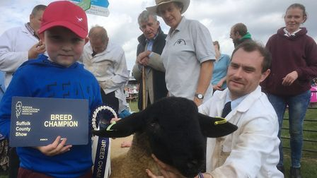 Sheep farmer Andrew Pinny, and son Freddie, with their five month old Suffolk ram which was named Su