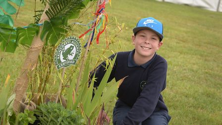 Daniel Revell with the Gorseland show garden that won Large Gold award. Picture: SARAH LUCY BROWN
