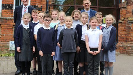 South Suffolk MP James Cartlidge and headteacher Ben Jeffrey with pupils at Glemsford Primary Academ