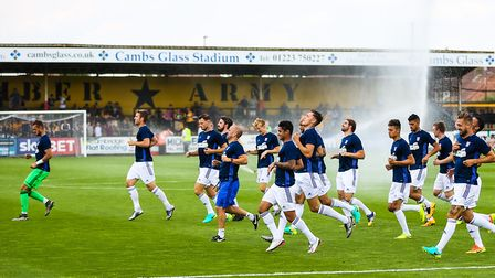 Ipswich Town players warm up at Cambridge United ahead of a friendly in 2016. Photo: Steve Waller