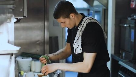 Tyler Markarian working in the kitchen of the Dog and Partridge pub in Bury St Edmunds Picture: GRE