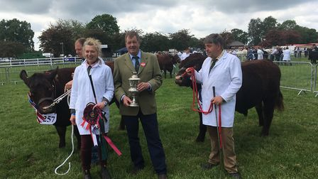 Natasha and Richard Mann with their Lincoln Red winners and, centre, judge Chris Page Picture: SARA