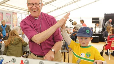 Bishop Martin Seeley in the Church of England Stand at the Suffolk Show after a table football game