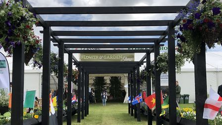 The pergola featured flowerbeds in the design of 16 flags of countries of the world, with the wooden