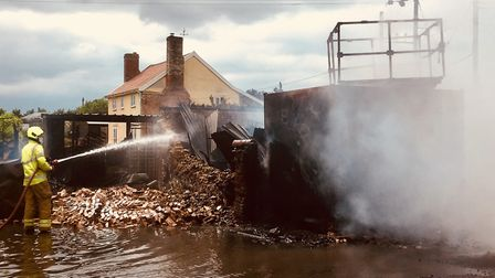 Suffolk firefighters spent hours sampening the buildings at the Great Barton cottage to make sure th