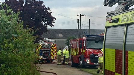 A large plume of black smoke left firefighters warning Great Barton residents to remain indoors and