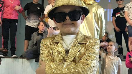 This youngster impressed with his 'bling' outfit when MC Grammar visited Castle Hill Primary School