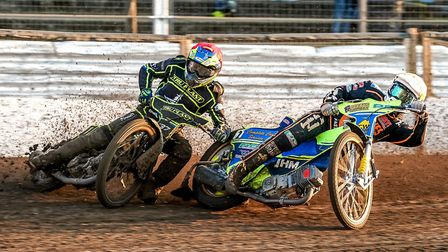 Chris Harris and Kyle Howarth battle in the opening heat, Ipswich v Wolves. Picture: Steve Waller