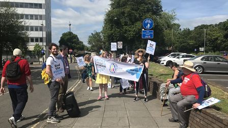 Councillor Jack Abbott (left), with the parents and children protesting against cuts to special need