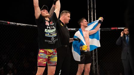 Steve Aimable has his hand raised at Cage Warriors 105. Picture: BRETT KING
