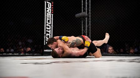 Craig Edwards takes Steven Hooper down in the second round of their fight at Cage Warriors 105. Pict