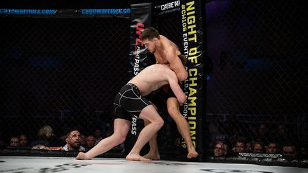 Craig Edwards attempts to fight off a takedown from Steven Hooper in their fight at Cage Warriors 10