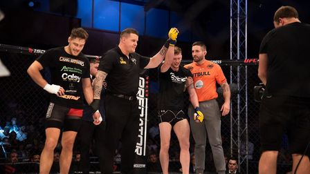 Steven Hooper has his hand raised after beating Craig Edwards at Cage Warriors 105. Picture: BRETT K
