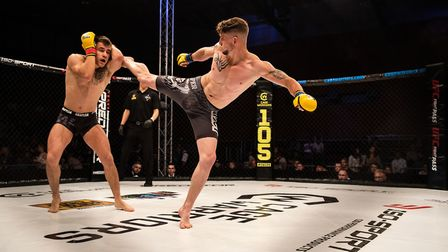 Tommy Gibbs lands a kick on Chey Veal's defences at Cage Warriors 105. Picture: BRETT KING