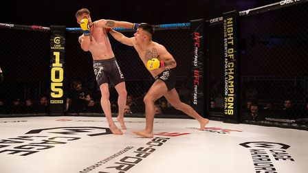 Norwich's Chey Veal looks to land a right hand on Tommy Gibbs in their fight at Cage Warriors 105. P