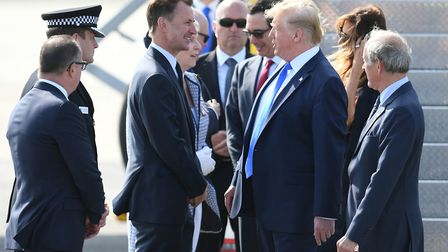 US President Donald Trump is greeted by Foreign Secretary Jeremy Hunt (left), as he and his wife Mel