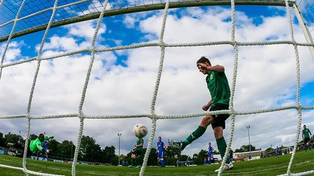 Everyone loves a bit of goalmouth action Photo: STEVE WALLER