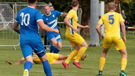 Brantham player/manager Michael Brothers delivers a cross for the Blue Imps. Picture: PAUL VOLLER