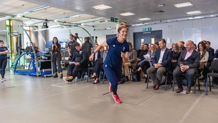 Olympic rugby player Amy Wilson-Hardy demonstrating the force plate at the University of Suffolk Hub