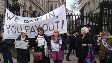 Suffolk campaigner Margaret Thompson (in the purple coat), with WASPI members, protesting at the ga