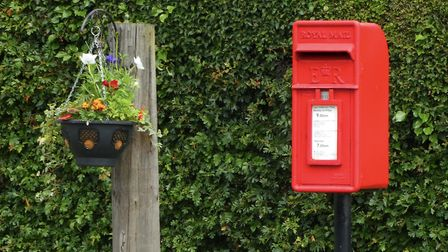 A post box and hanging basket Picture: JANE DEVILLE