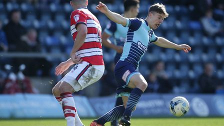 Wycombe Wanderers need to cut their budget this summer. Midfielder Dominic Gape (right) could depart