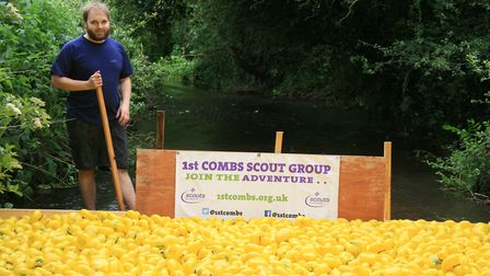 Cub scout leader Chris Frost marshals the ducks ready for the start Picture: MARK LANGFORD